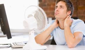 Man Being cooled off by a fan